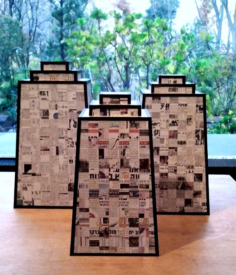 TOWERS OF BABEL | International newspapers, collage. Tallest tower is 50cms x 28cms x 28cms.