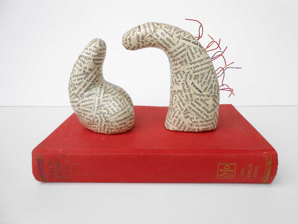 BEDSIDE MANNER | Old medical textbook, telephone wire, modelling-clay. 23cms x 16cms x 16cms