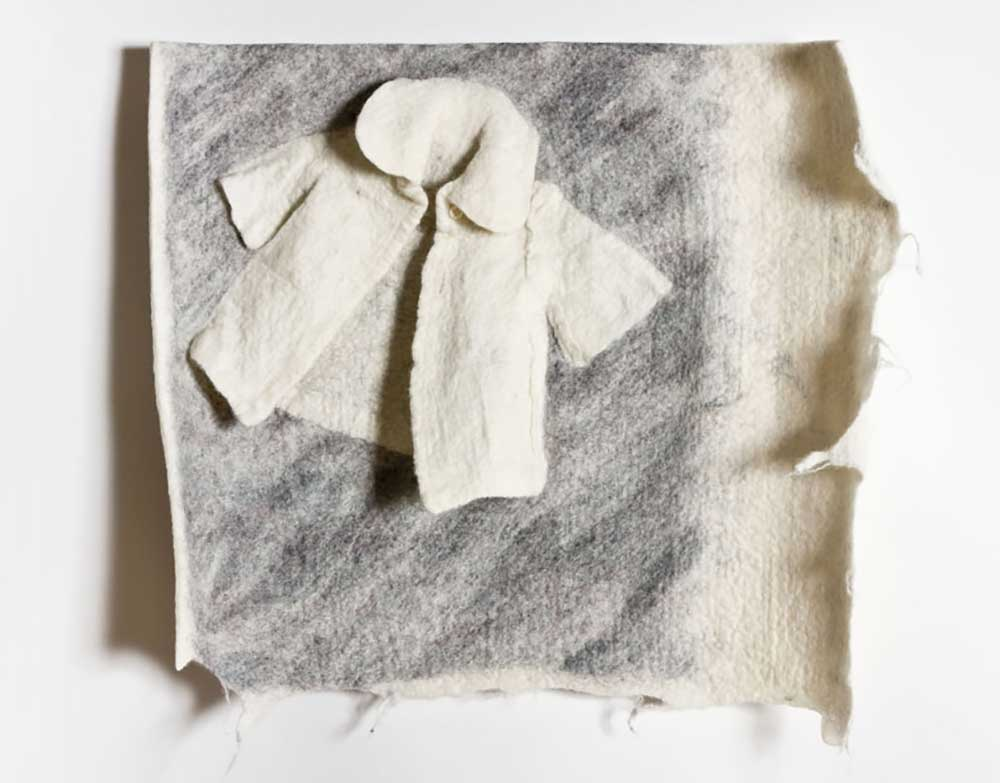 DOLL'S COAT | Hand made felt; 60cm x 50cm. Photo: David Ramkalawon.