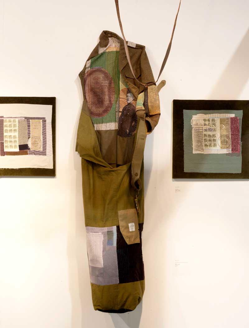 DECORATED   Vintage army uniform and kitbag, appliqué, hand and digital machine stitch. Size: 60cm x 220 cm. Date: 2014