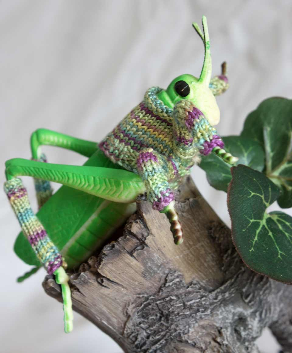 RANDOM ACTS OF KINDNESS (SERIES 2) | Hand knitted silk on toy insect in bell jar 25cm x 20cm.