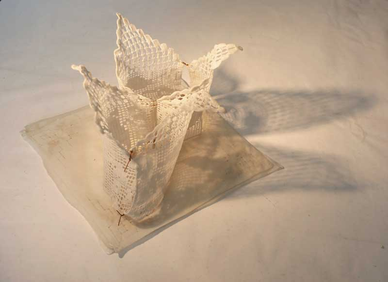 <strong>WAX VOTIVE</strong>  2012 <strong>|</strong>  29 cm X 15 cm X 15 cm beeswaxed lace and handkerchiefs, metal wire.