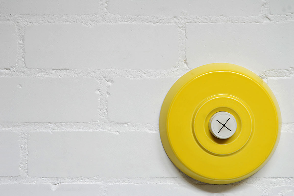 PUSH | Wall-mounted ceramic, yellow glaze, slip cast earthenware, rubber component; 30cm diameter. Photo: Pete Beardsmore