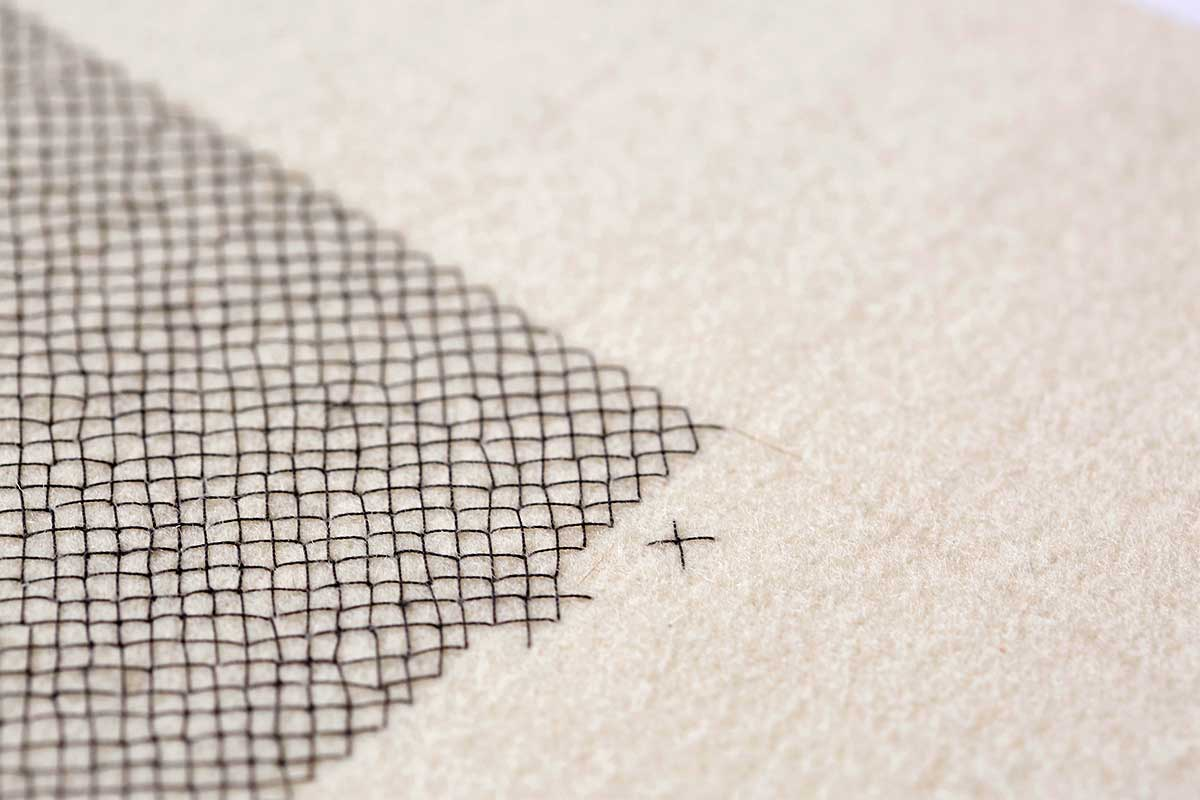 DISPLACED | Hand embroidered, cotton on wool, 28cms x 56cms. Photo: Yeshen Venema.
