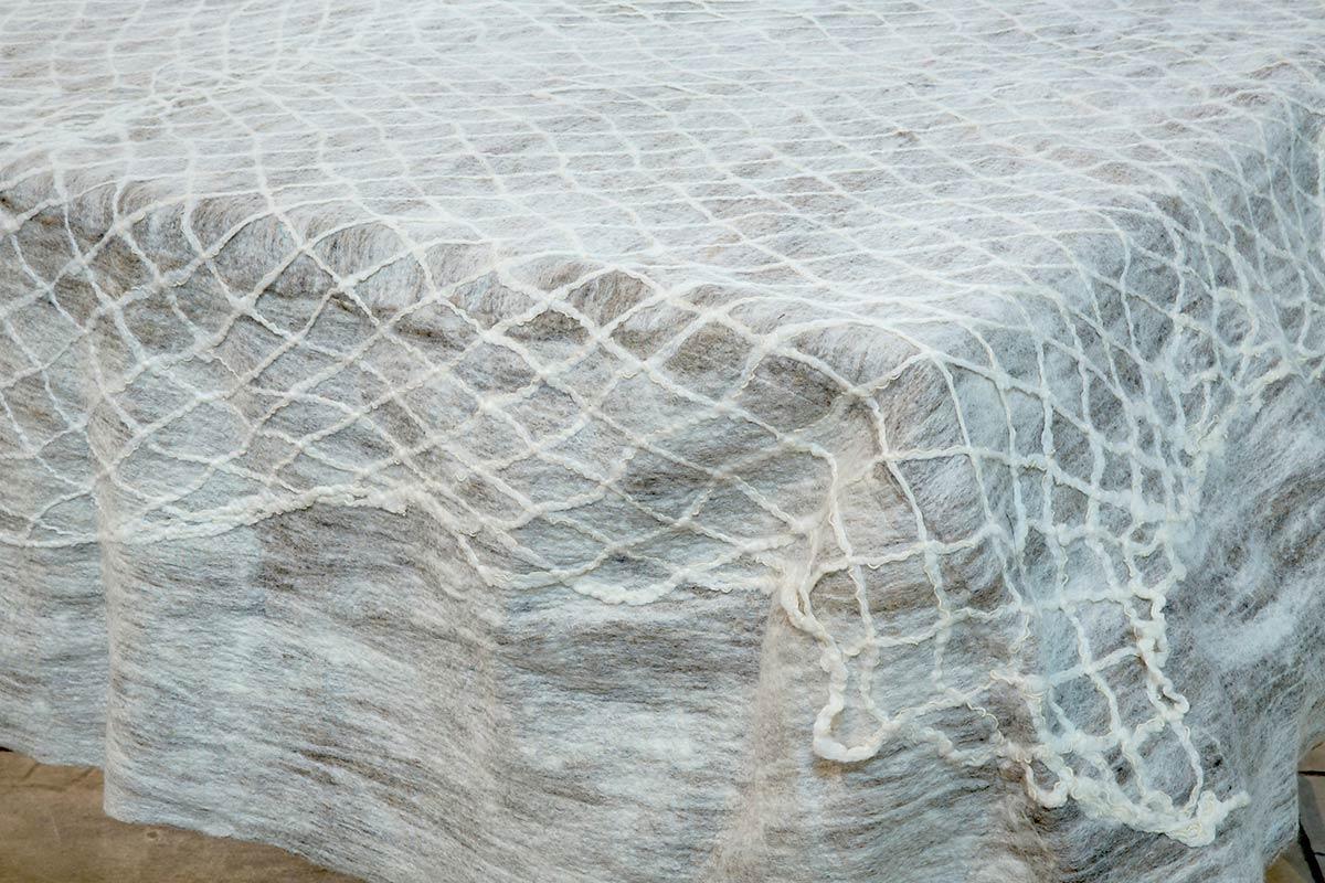 TRAPPED SILENCE (Detail) | Hand made net and felt; 230cm x 160cm x 40cm. Photo: David Ramkalawon.