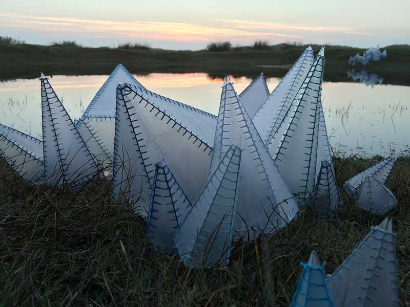 TO REFLECT | Installation made around a small pond on the island Ameland, The Netherlands in 2015 with sewed plastic sheets.