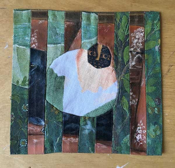 BLACK DOG | 2016 19cm x 15.6cm repurposed found oil painting, found cotton tea towel, patchwork and reverse applique.
