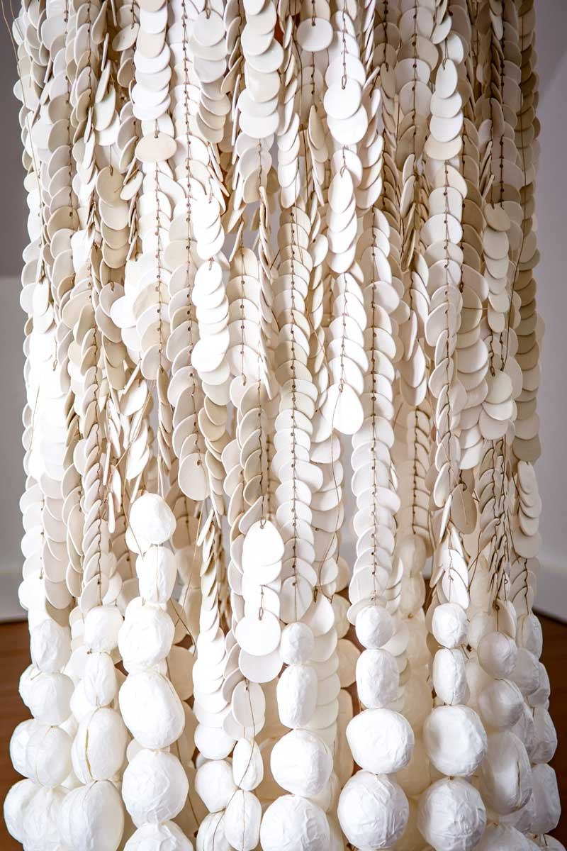 WATERFALLS (detail) 2017   Installation made up of 3000 porcelain pellets and 600 paper balls tied together with paper thread. Paper, paper thread, porcelain   Techniques: papier mâché, modelling, knotting   Size: Height 240 cm X diameter 70 cm