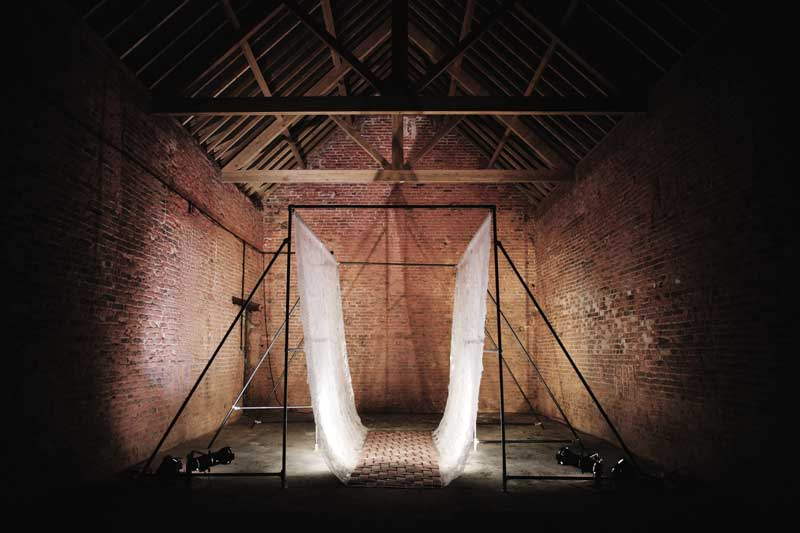 AVENUE 2016 |Materials: Polythene sheeting, decommissioned fire-hose, Fastclamp structure, plastic eyelets, brass eyelets | Technique: Handwoven | Size: 5m x 5m x 5m | Image credit: John Hesford.