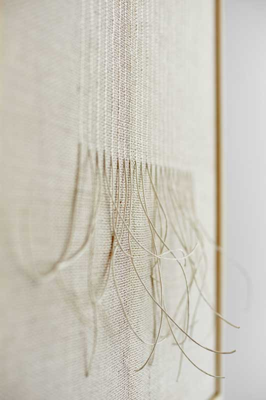 Mapping (White) 2021 | Materials: linen/metallic yarn, paper | Techniques: handwoven and hand-knotted | Size:  63cm x 53cm x 3cm | Image credit: Christina Hesford.